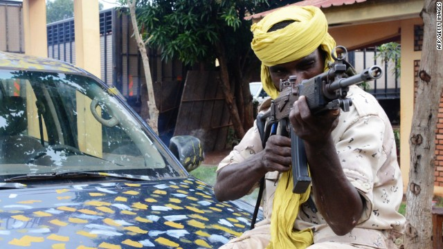 A Seleka fighter poses holding his weapon on July 25, 2013 at the Bangui firefighters barracks, turned into a Seleka base.