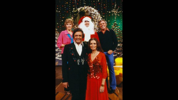 """Anne Murray, clockwise from upper left, Kaufman as Santa, Tom T. Hall, June Carter Cash and Johnny Cash appear on the """"Johnny Cash Christmas Special"""" on CBS in 1979."""