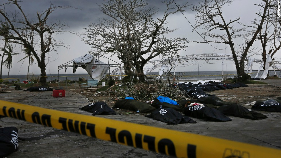 Dozens of bodies are placed near Tacloban City Hall on November 14 as workers prepare a mass grave on the outskirts of the hard-hit city.