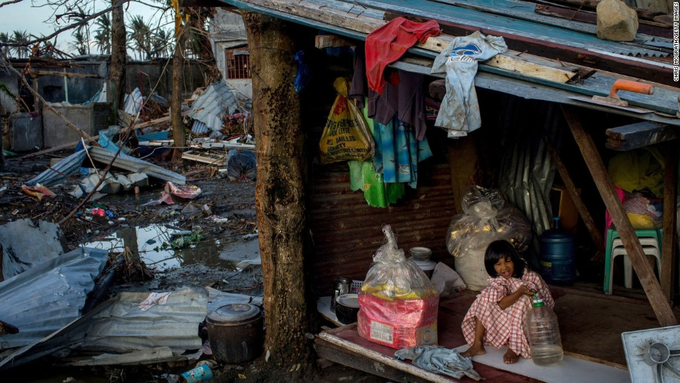A girl plays inside her house amid the devastation in Tacloban on November 14.