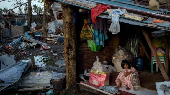 A girl plays inside her house amid the devastation in Tacloban on November 14.