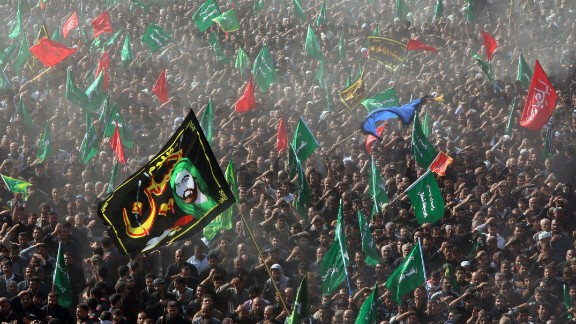 Thousands of Shiite Muslims take part in a ritual ceremony of Ashura in Karbala, Iraq, in 2013.
