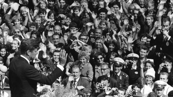 """U.S. President John F. Kennedy delivers his famous """"Ich bin ein Berliner"""" (""""I am a Berliner"""") speech to a massive crowd in West Berlin on June 26, 1963."""