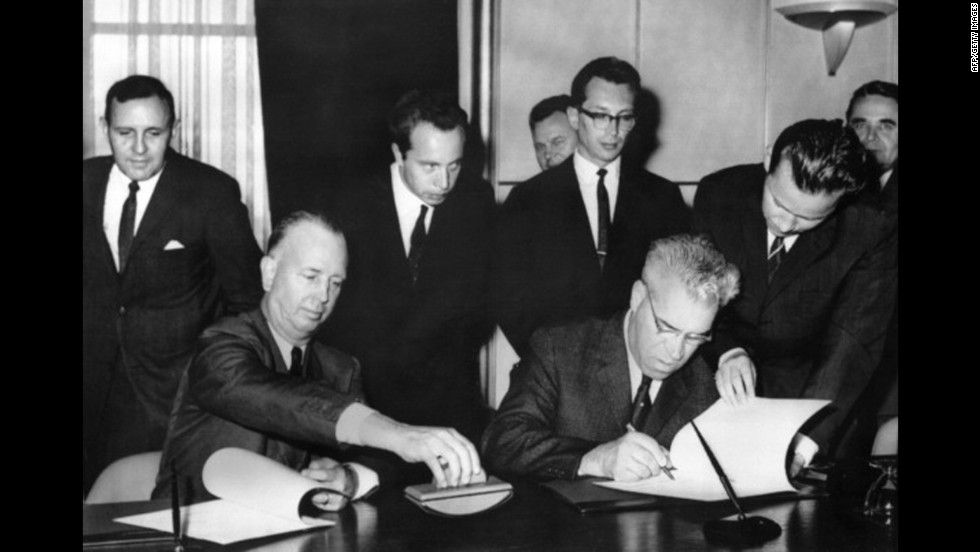 "United States representative Charles Stelle, left, and his Soviet counterpart, Seymon Tsarapkin, meet on June 20, 1963, in Geneva, to sign the Memorandum of Understanding Regarding the Establishment of a Direct Communications Line, an agreement to set up a hot line between the two superpowers. The ""red phone"" between Washington and Moscow was declared operational August 30, 1963."