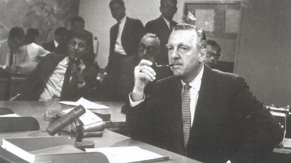"""Walter Cronkite sits behind the news desk on the set of the """"CBS Evening News with Walter Cronkite"""" in August 1963. One month later, it became network television's first nightly half-hour news program."""