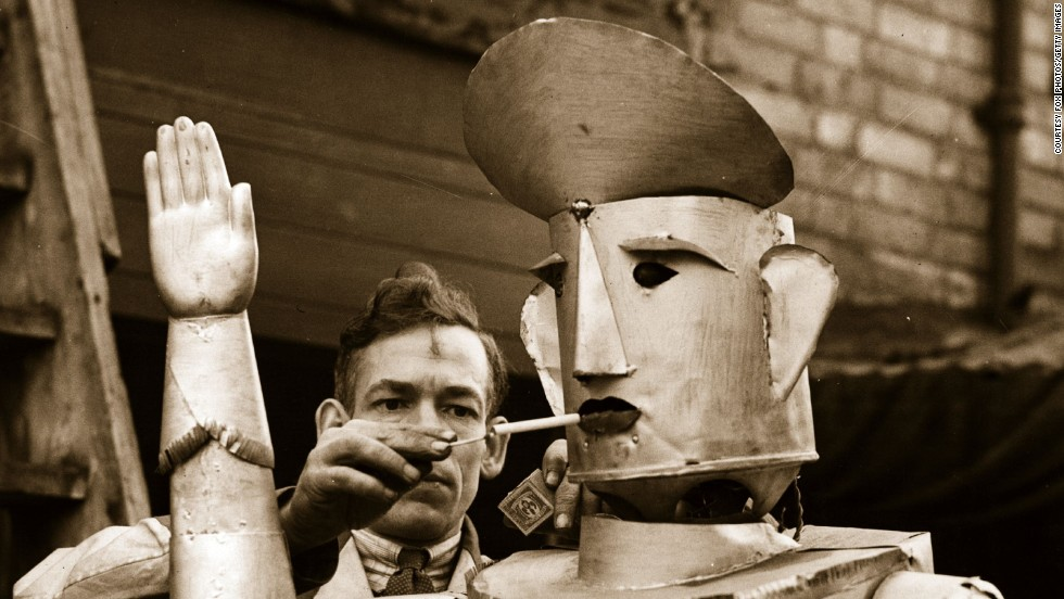 Look we've all got our vices ok? Even tin men. The most pointless function for any robot ever, devised purely as a means to resemble man, electrical engineer Charles Lawson built a robot that could smoke. You have to feel for the robot -- a coerced addict. Shame on you Mr Lawson.