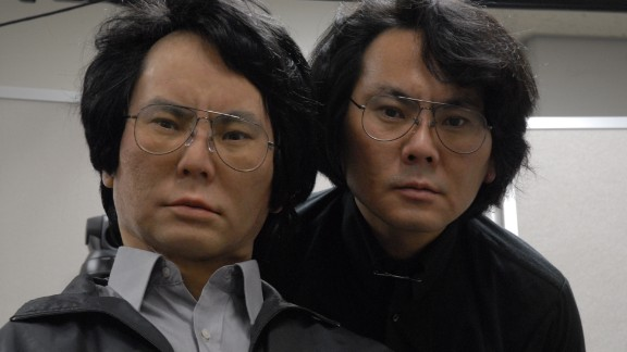 """OK so we seem to like making robots look like humans. But this guy had to take it one step further and build a mechanical version of himself, complete with imitation mannerisms and facial expressions. Hiroshi Ishiguro is the director of Japan's Intelligent Robotics Laboratory, who developed the first """"actroid,"""" a humanoid robot with features and functions almost indistinguishable from a human's."""