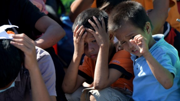 Children gather at the Tacloban airport on November 15. Many survivors have converged on the city