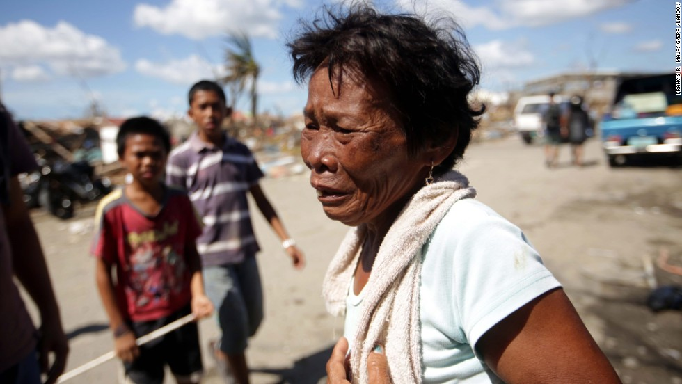 A survivor reacts to the damage at a residential area in Tacloban on November 15.