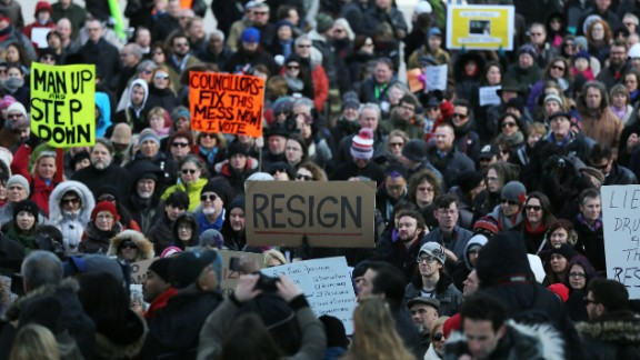 Hundreds gather in Toronto's Nathan Phillips Square on Wednesday, November 13, to call for Ford to resign.