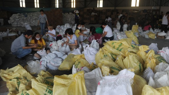 Volunteers in Manila, Philippines, prepare relief goods for typhoon survivors on Thursday, November 14.