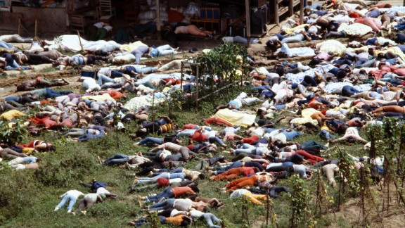 Bodies lie around the compound of the People