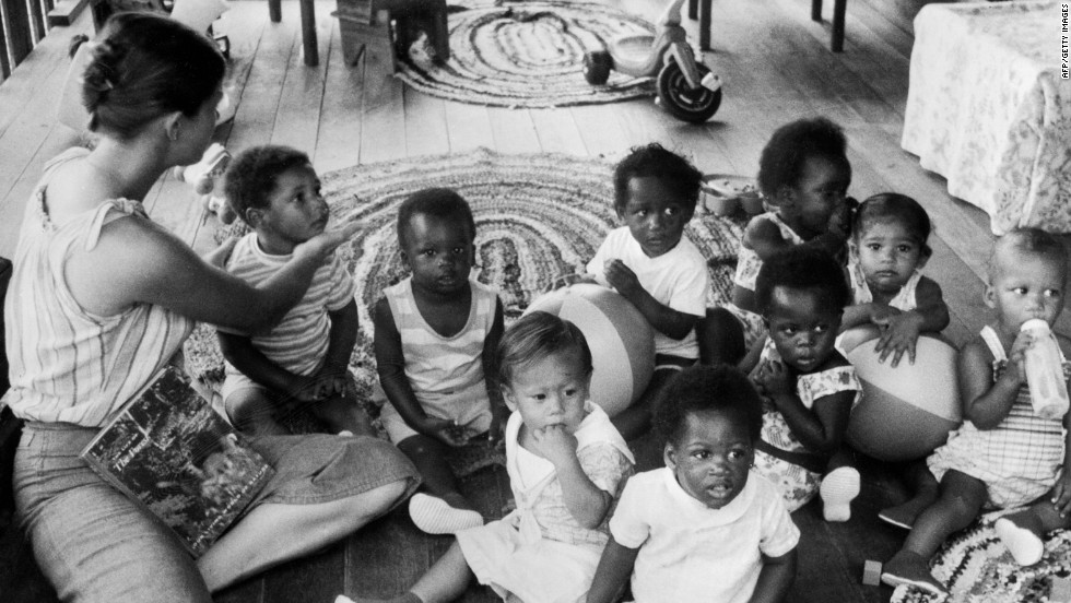 Children of People's Temple members are tended to in the nursery of the sect in 1978, in Georgetown. (It was renamed Jonestown after the sect's leader).