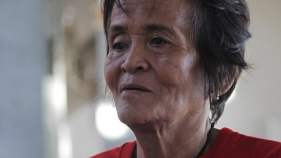 """Arsenia Orioque, 74, had come to the church to pray and to take advantage of the medical services being offered there each afternoon. She seldom came to church before the storm struck, but now she says she can find peace there. """"In my prayers, I give thanks that I survived the typhoon,"""" she said."""