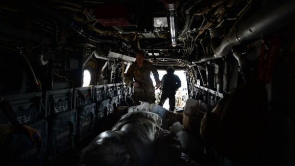 A U.S. Army Ranger unloads aid from an Osprey aircraft November 16 in Balangiga, Philippines.