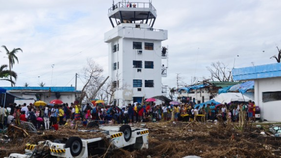 Survivors gather in Tacloban to await transport to a neighboring province on November 16.