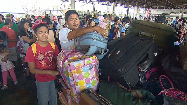 Philippines survivors crowd airport