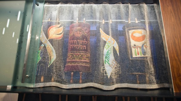 The synagogue's Torah scrolls are held in an ark at the front of the sanctuary. Its design was a group effort involving the architects and members of the congregation.