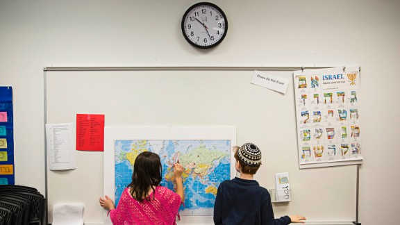 Children mark countries on a map during class at Congregation Or Hadash on a recent Sunday.