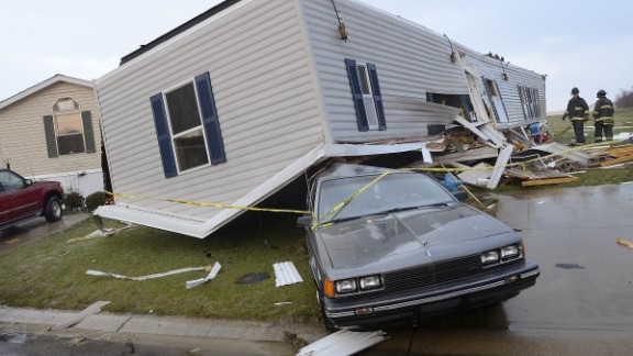 Firefighters look over damage to trailers at Summit Village, east of Marion, Indiana, after storms blew through Marion and Grant County, northeast of Indianapolis, on November 17.