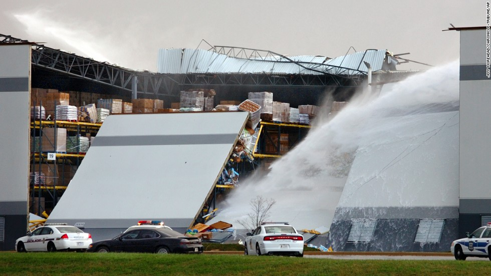 Water shoots from broken pipes after part of a wall and roof collapsed on November 17 at the Dollar General distribution center east of Marion, Indiana.