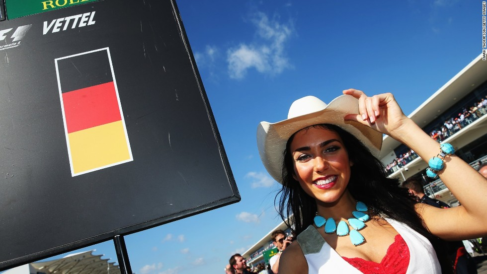 A Circuit of America's grid girl holds the board assigned to four-time champion and eventual race winner Sebastian Vettel.