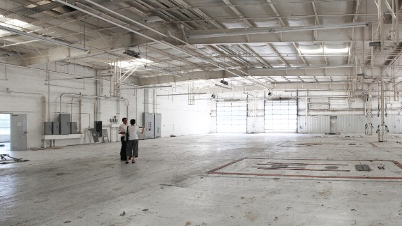 The interior has changed dramatically, but the old concrete floor remains throughout the building.