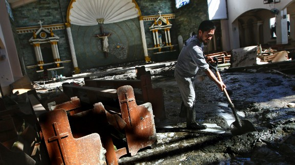 A man cleans up mud inside a church in the hard-hit city of Tacloban on November 18.