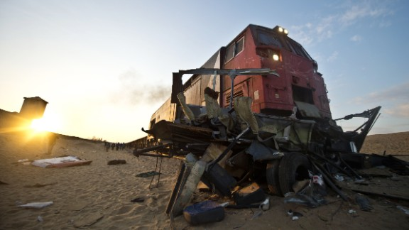 The wreckage of a minibus lies at the site of an accident near a railway crossing in Dahshur, Egypt, on Monday.