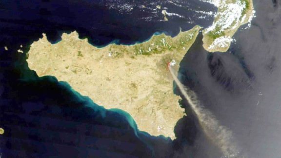 In this photo provided by NASA, Etna is seen from space spewing smoke and ash in 2001.
