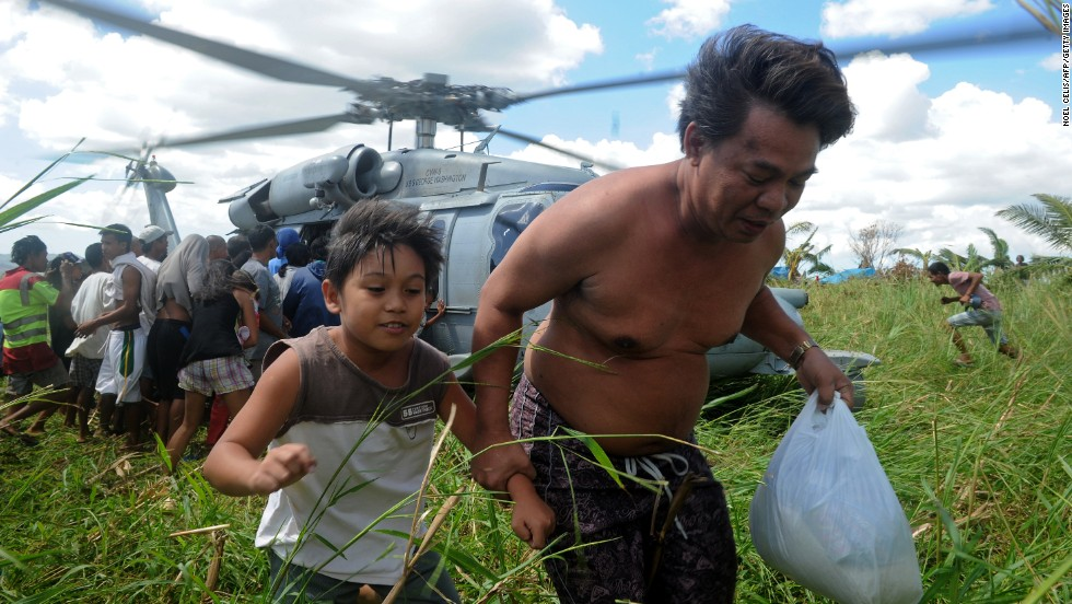 A U.S. Navy helicopter delivers relief goods to typhoon victims in Ormoc, Philippines, on November 18.