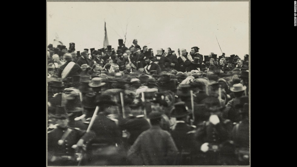 A crowd gathers to hear President Abraham Lincoln deliver the Gettysburg Address on November 19, 1863. Lincoln is seen in the center, just to the left of the bearded man with a top hat.