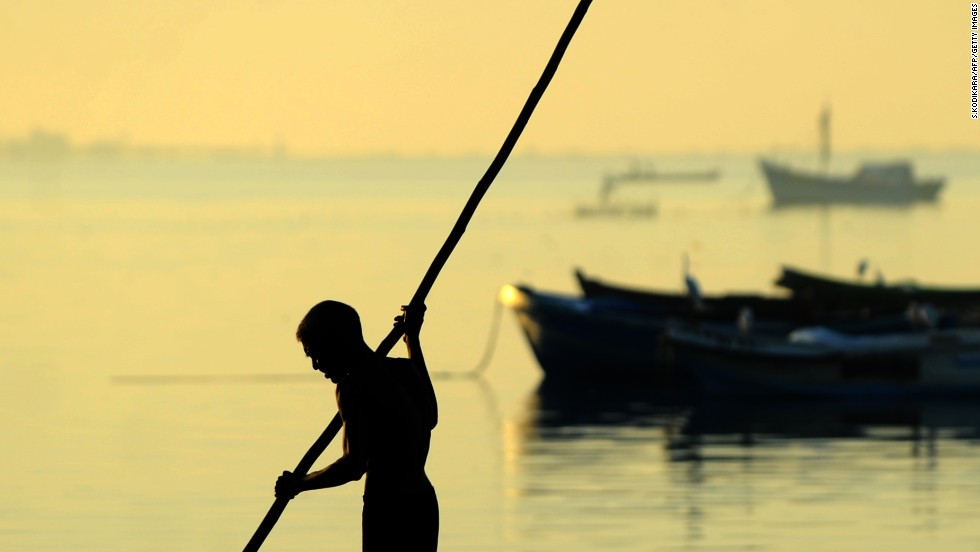 "NOVEMBER 18 - JAFFNA, SRI LANKA: A Tamil fisherman paddles his boat along the shoreline. Meanwhile in the capital Colombo, Commonwealth leaders signed agreements on issues such as poverty and development as they staged a show of unity after a summit dominated by a <a href=""http://www.cnn.com/2013/11/14/world/asia/sri-lanka-commonwealth-nonis/"">bitter dispute over war crimes claims</a>."