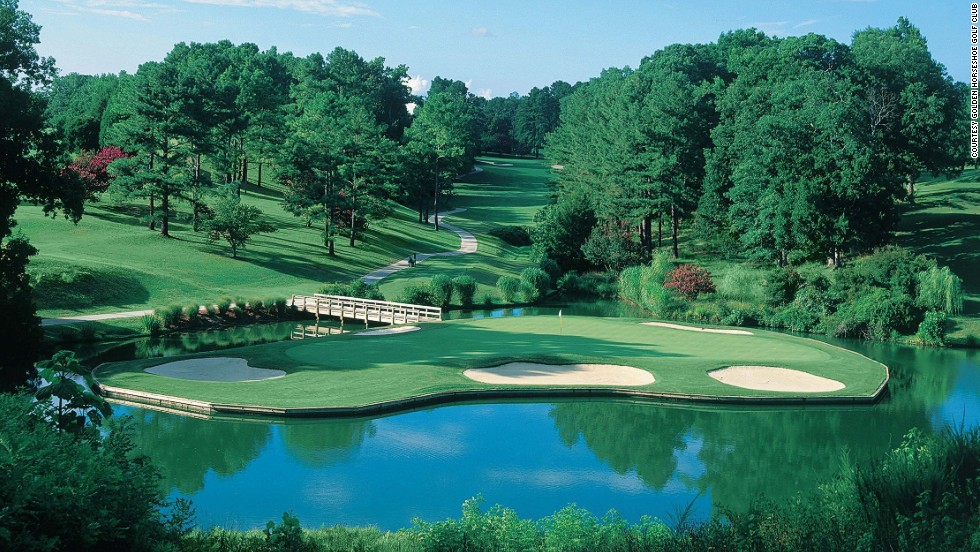 <strong>16th hole at the Gold Course, Golden Horseshoe Golf Club, Williamsburg, Virginia. </strong>Designed by noted golf course architect Robert Trent Jones Sr., the Gold Course has a gem of an island green. From the tee of the 169-yard par three, golfers fire a short iron over a wide lake to the bunker-protected green. If you can't admire your shot, there is always the beautiful tree-lined vista in the background to take your mind off things.<br />