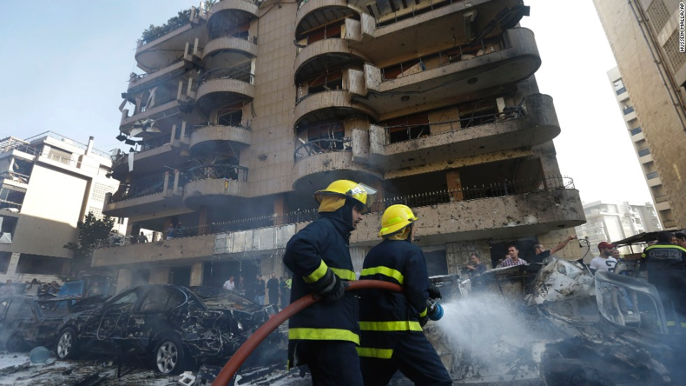 Firefighters extinguish burning cars in Beirut, Lebanon, where two explosions went off near the Iranian Embassy on Tuesday, November, 19, killing nearly two dozen people.