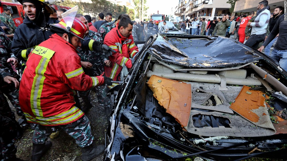 Lebanese Red Cross workers pull a body from a car in Beirut on November 19.