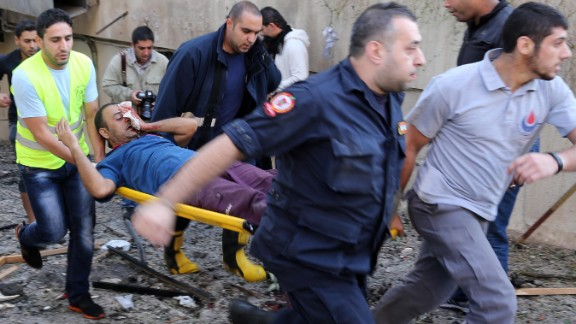 Rescue workers evacuate a man from the site of the blast.
