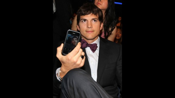 Actor Ashton Kutcher poses in the audience during the 2010 People