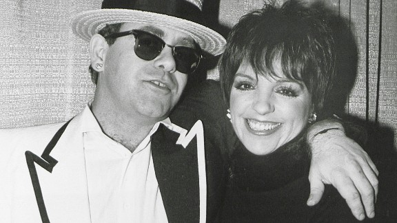 John with actress and singer Liza Minnelli in 1990.