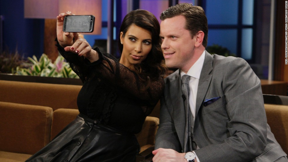 "Television personalities Kim Kardashian and Willie Geist take a selfie during ""The Tonight Show with Jay Leno."""