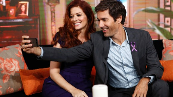Actors Eric McCormack and Debra Messing take a selfie while appearing on NBC