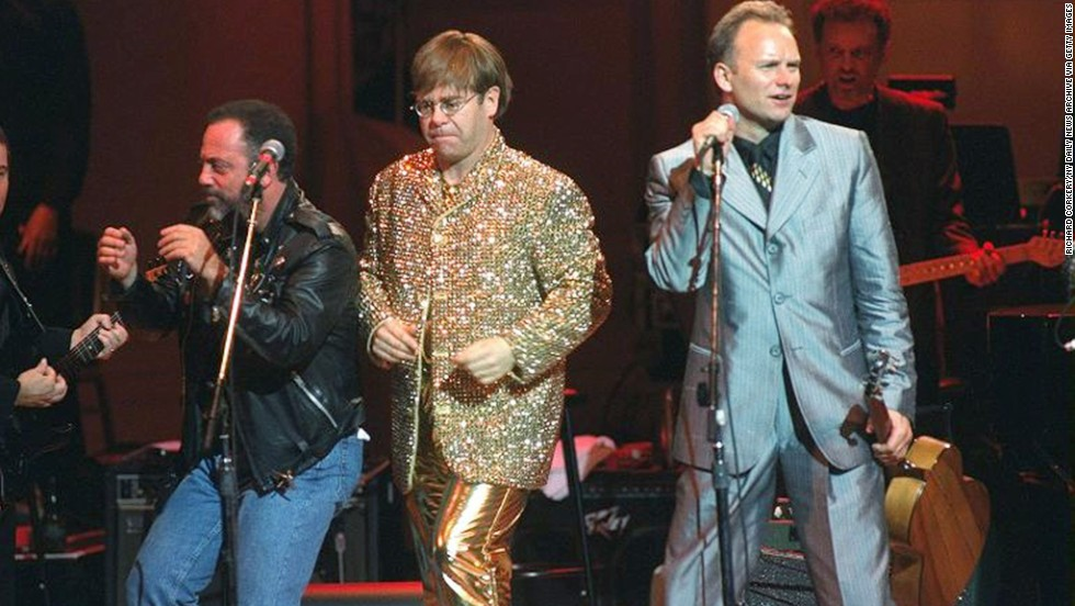From left, Billy Joel, John and Sting perform at a benefit concert for the Rainforest Foundation in 1995. Joel and John toured together often during their careers.