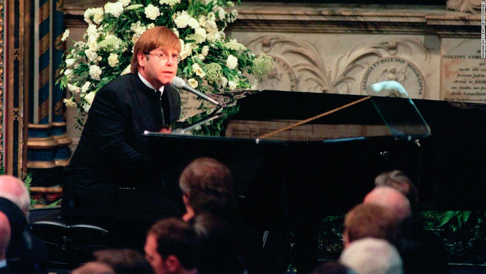 "John sings ""Candle in the Wind"" at Princess Diana's funeral in 1997. The tribute became one of the best-selling singles of all time. Proceeds were donated to charity."