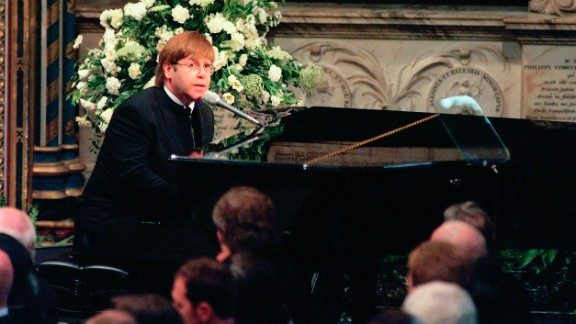 """John sings """"Candle in the Wind"""" at Princess Diana's funeral in 1997. The tribute became one of the best-selling singles of all time. Proceeds were donated to charity."""