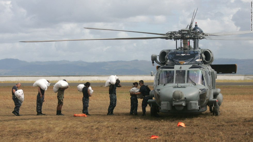 U.S. troops load relief supplies onto a helicopter in Tacloban, Philippines, on Tuesday, November 19.