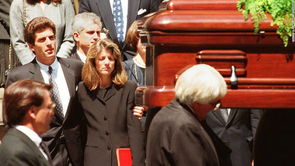 Kennedy and her brother watch as their mother's casket is carried away from a New York City church in 1994.