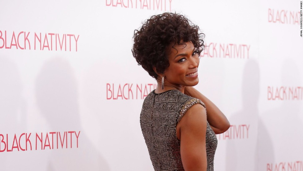 "Angela Bassett gives a last look at the ""Black Nativity"" premiere at The Apollo Theater on November 18 in New York City."