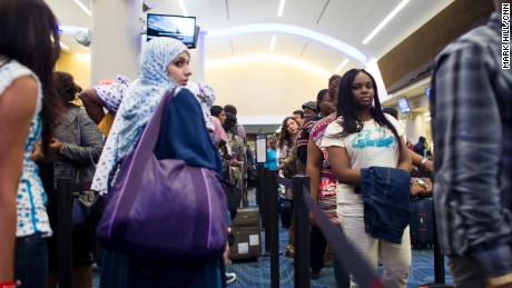Passengers wait at a customs checkpoint at Atlanta's Hartsfield-Jackson International Airport.