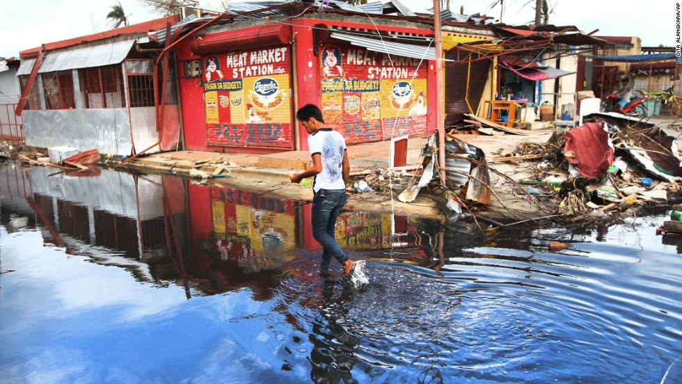 A man walks through water in the typhoon-ravaged city of Tacloban, Philippines, on November 20.