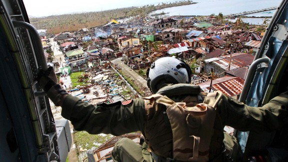A crew member aboard a U.S. Navy helicopter looks out over Lawan, Philippines, before dropping relief goods November 20.